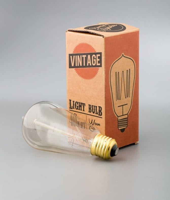pear squirrel cage filament vintage bulbs with cardboard packaging against white background