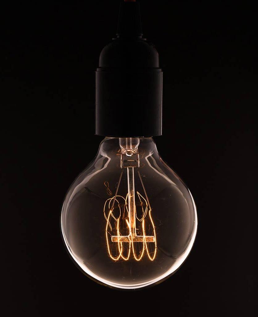 medium globe quad loop vintage filament bulbs against black background
