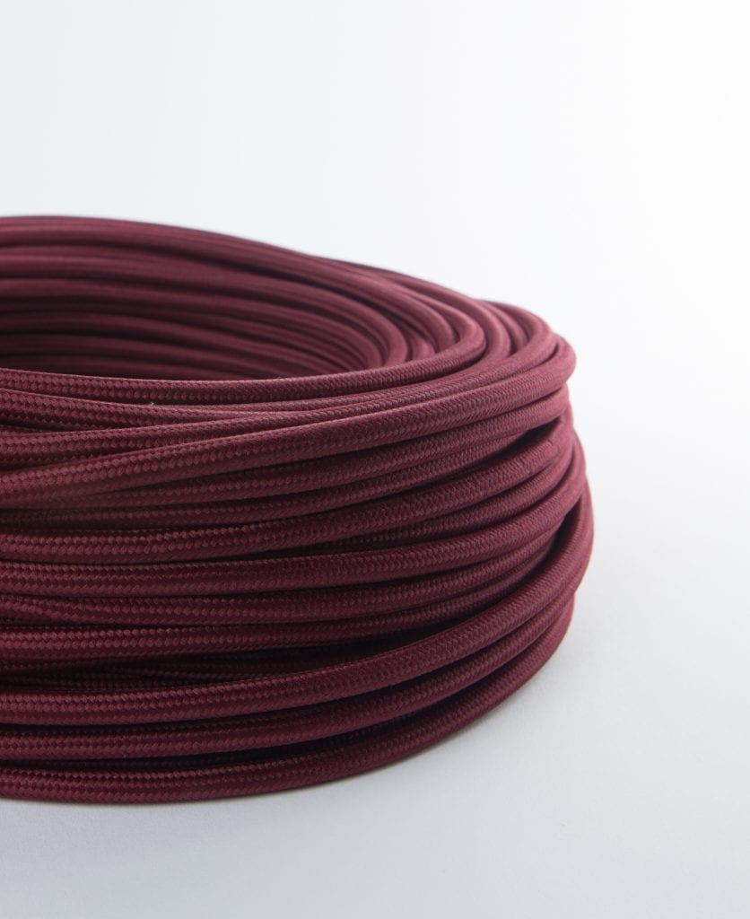 burgundy red wine fabric cable for lighting against white background