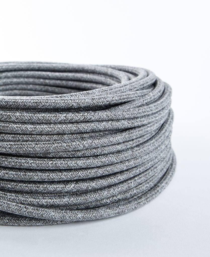 Old grey jumper weave fabric cable for lighting against white background