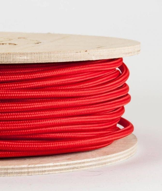 Close Up Red Smooth Fabric Cable On Wooden Reel On White Background