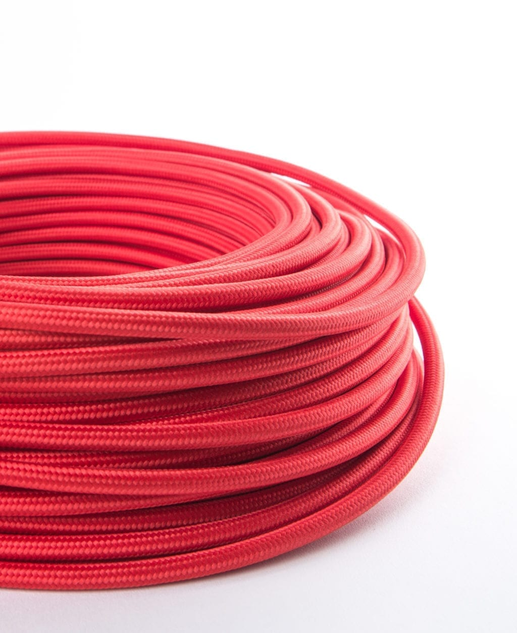 Close Up Red Smooth Fabric Cable Coil on White Background