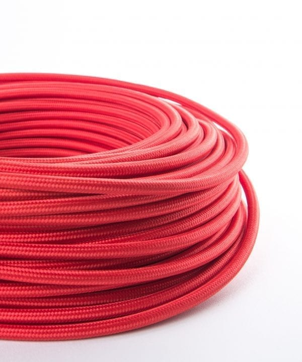 closeup of red fabric cable coil against white background