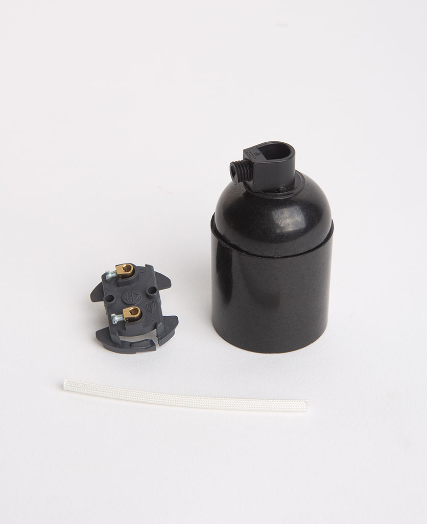 black thermoplastic lamp holder with inserts against white background
