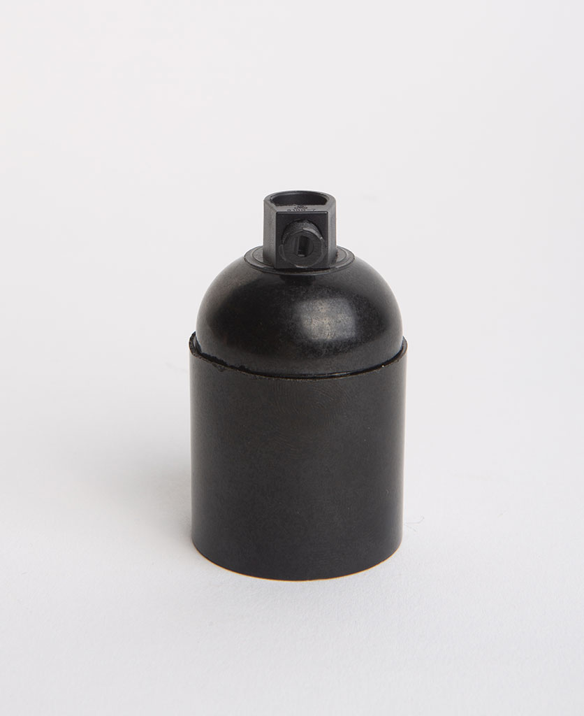 black thermoplastic lamp holder against white background
