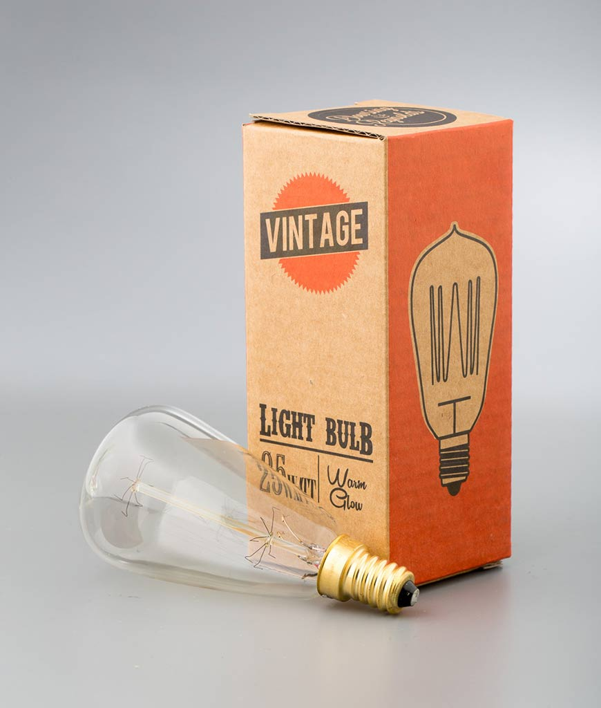 small vintage light bulb pear with squirrel cage filament