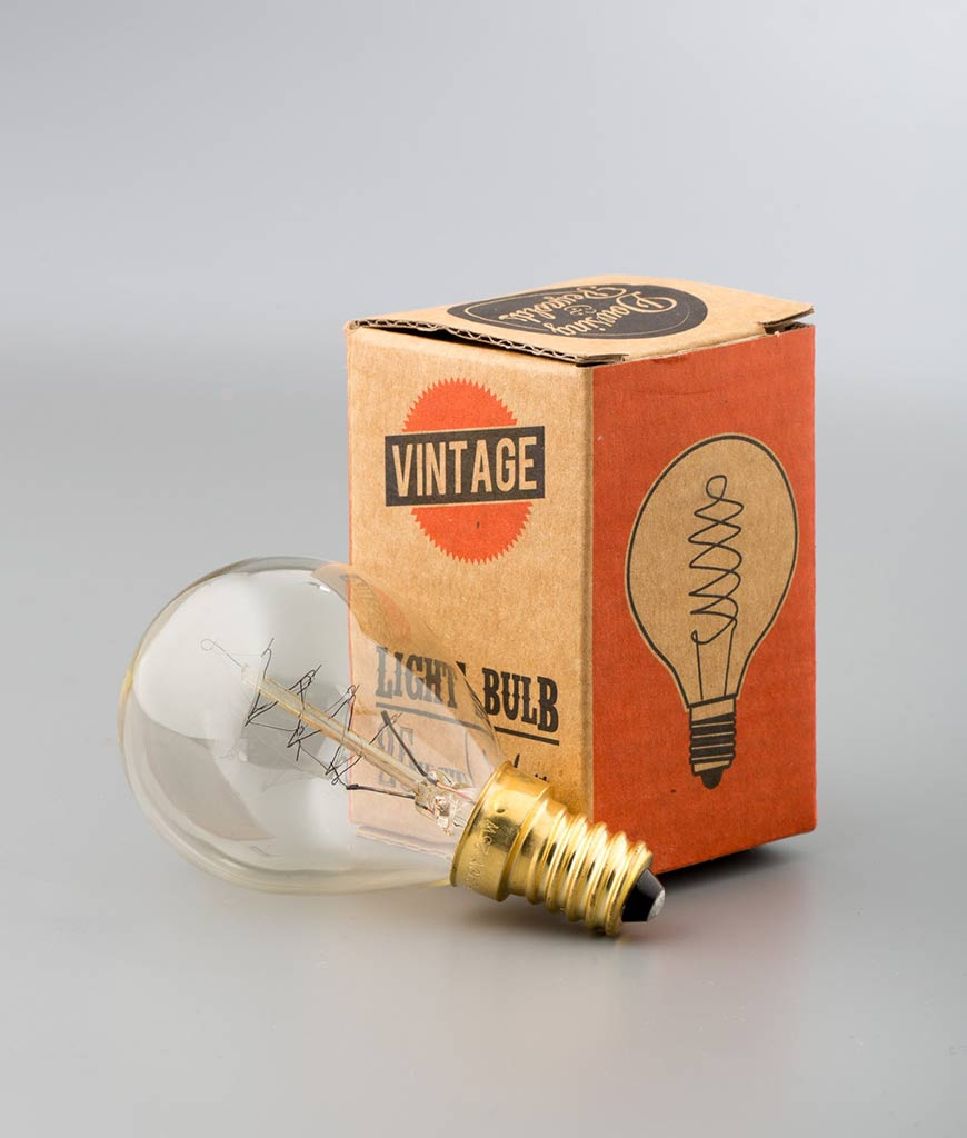 spiral filament small ball e14 light bulbs with cardboard packaging against white background