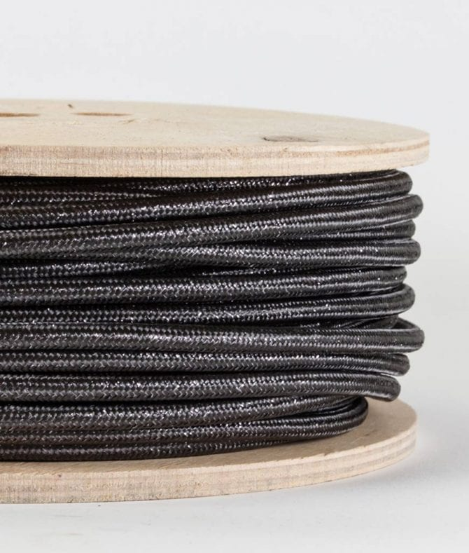 closeup of glamour grey fabric cable on reel against white background