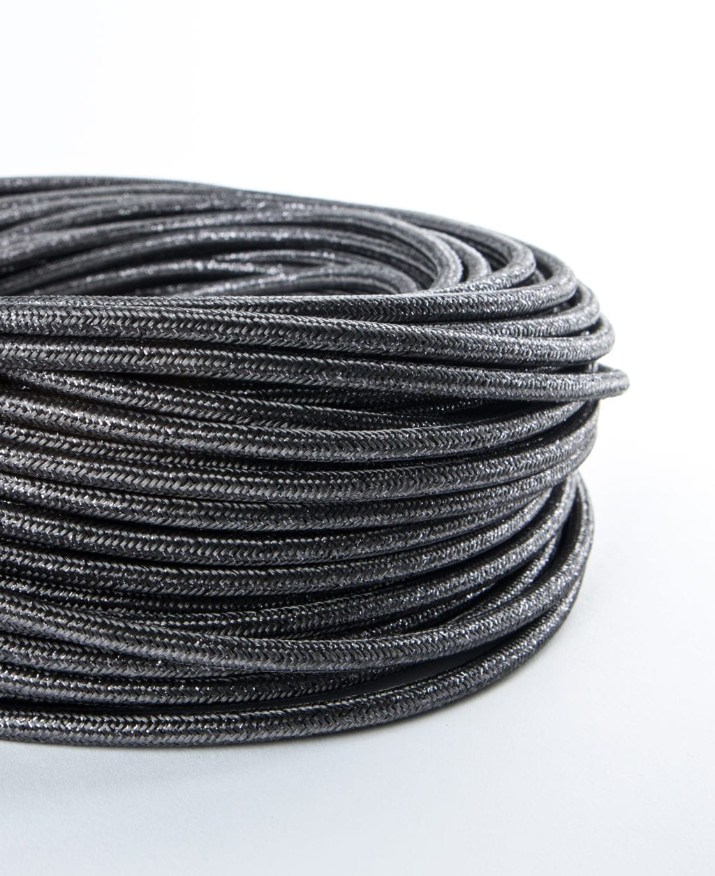 closeup of glamour grey fabric cable coil against white background