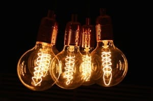 five globe vintage light bulbs with loop filaments