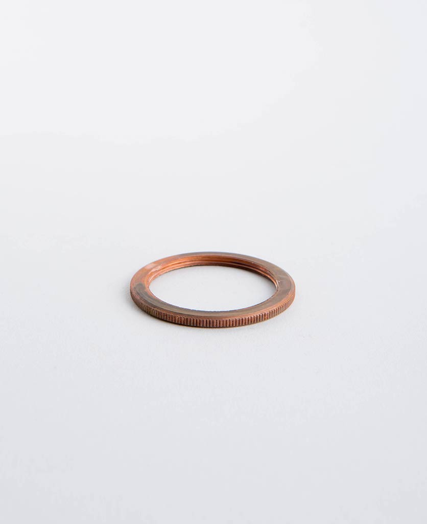 tarnished copper lamp ring