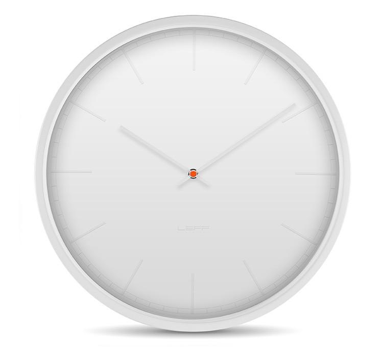white interiors white leff wall clock