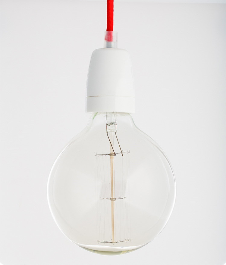 white porcelain pendant with coloured fabric cable