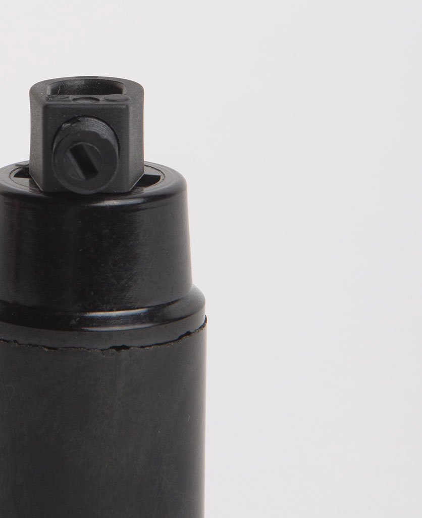 closeup of black thermoplastic e14 bulb holder against white background