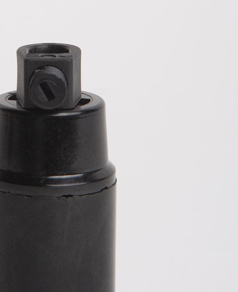 closeup of black bakelite e14 bulbholder against white background