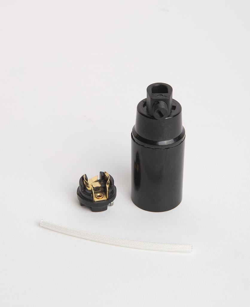 black bakelite e14 bulbholder with insert against white background