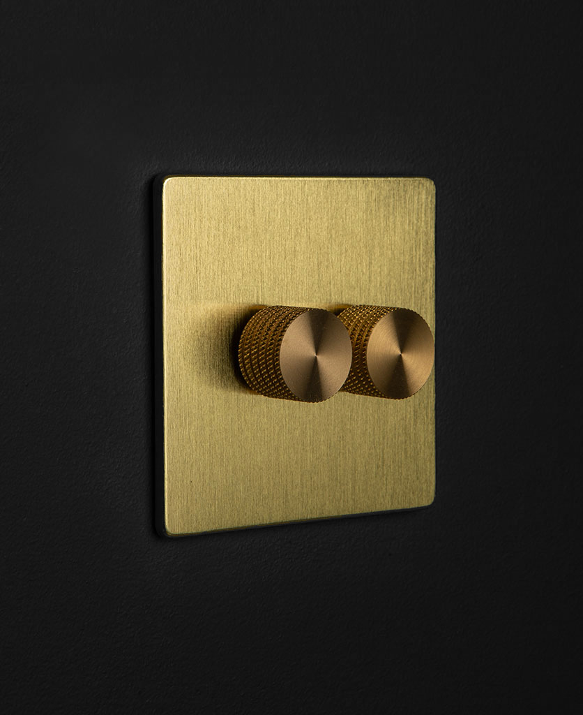 brass dimmer switch with 2 gold dimming knobs