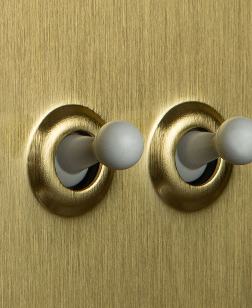 Double gold toggle switch with white toggles