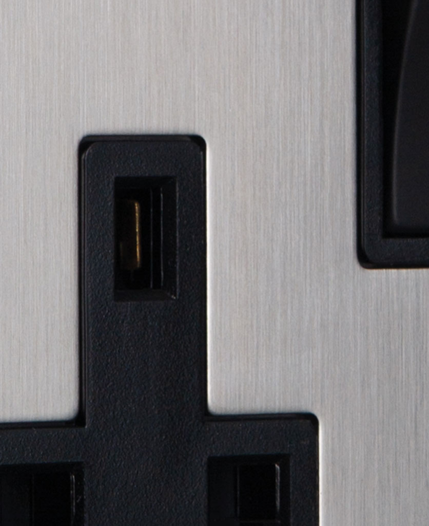 closeup of silver plug socket with black insert