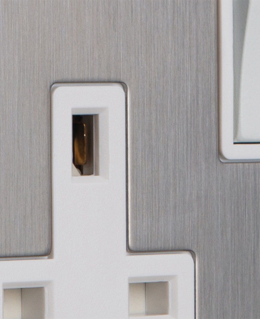 closeup of silver plug socket with white insert