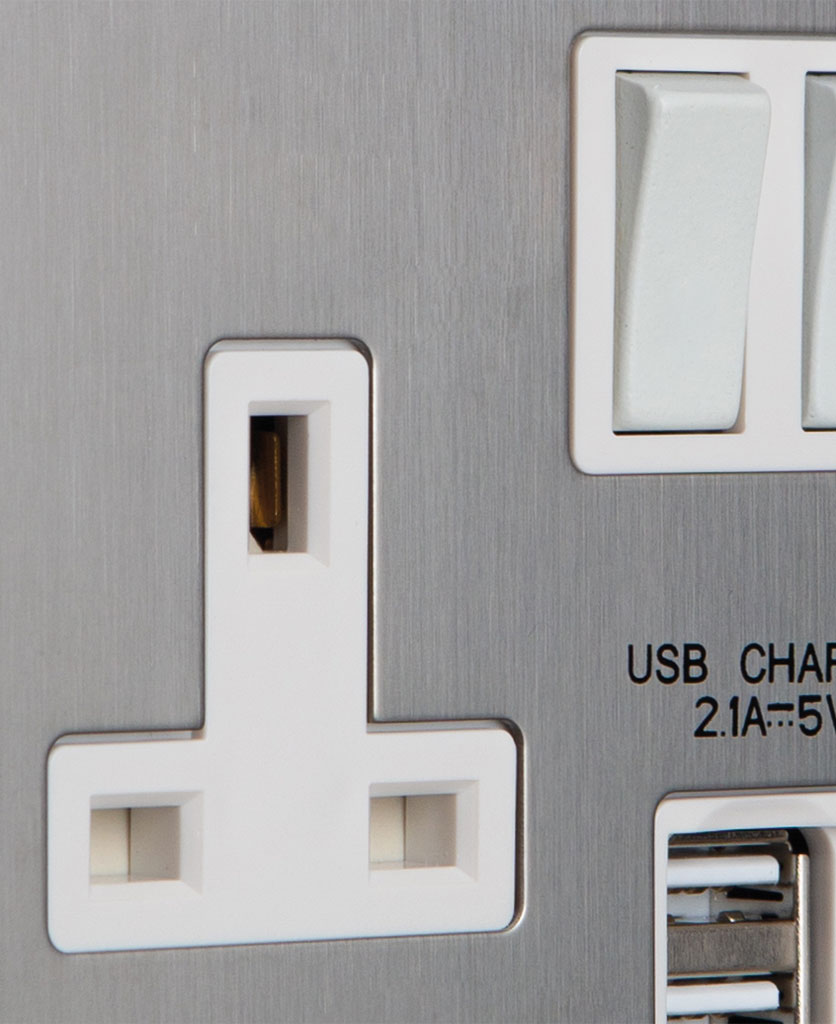 closeup of silver socket with white plug socket and usb port