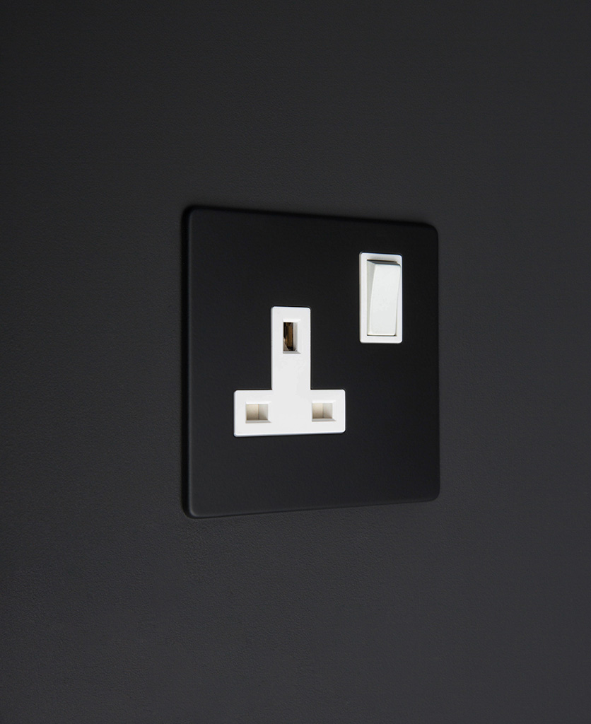 black and white 1g single plug socket on black background