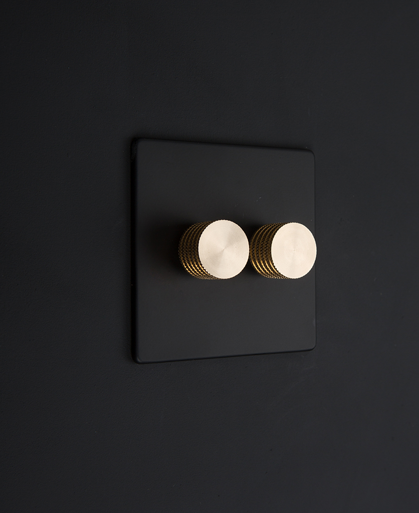 black double dimmer switch with gold knurled dimming knobs