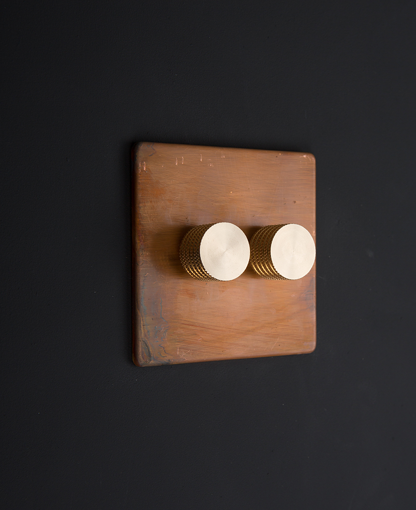 Copper LED double dimmer switch with gold knurled dimming knobs