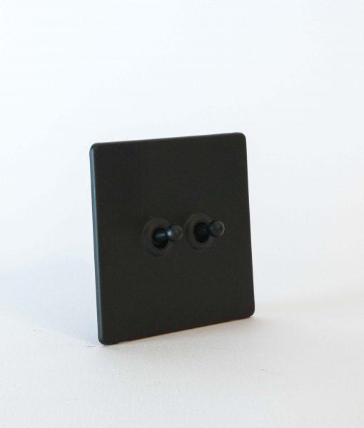 toggle light switch 2 toggle black black designer light switches. Black Bedroom Furniture Sets. Home Design Ideas