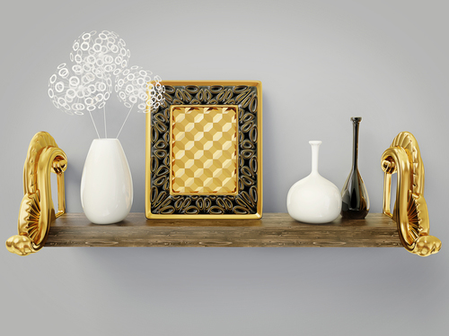 wooden shelf with brass photo frame and white an black vases against soft grey wall