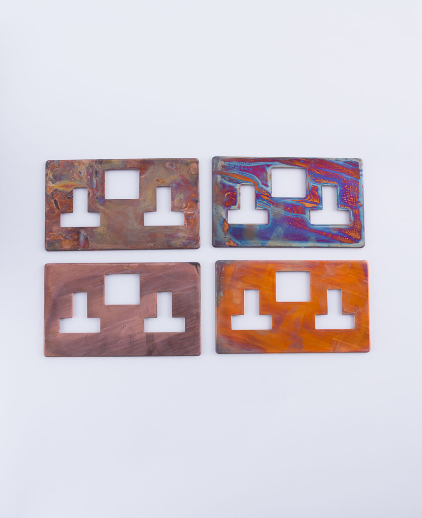 tarnished copper switch plate variations four plates on a white background