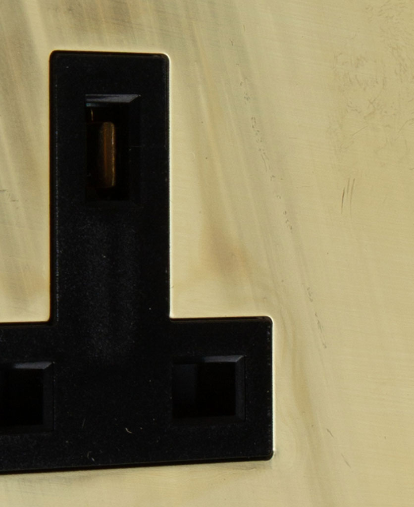 smoked gold and black single unswitched socket close up
