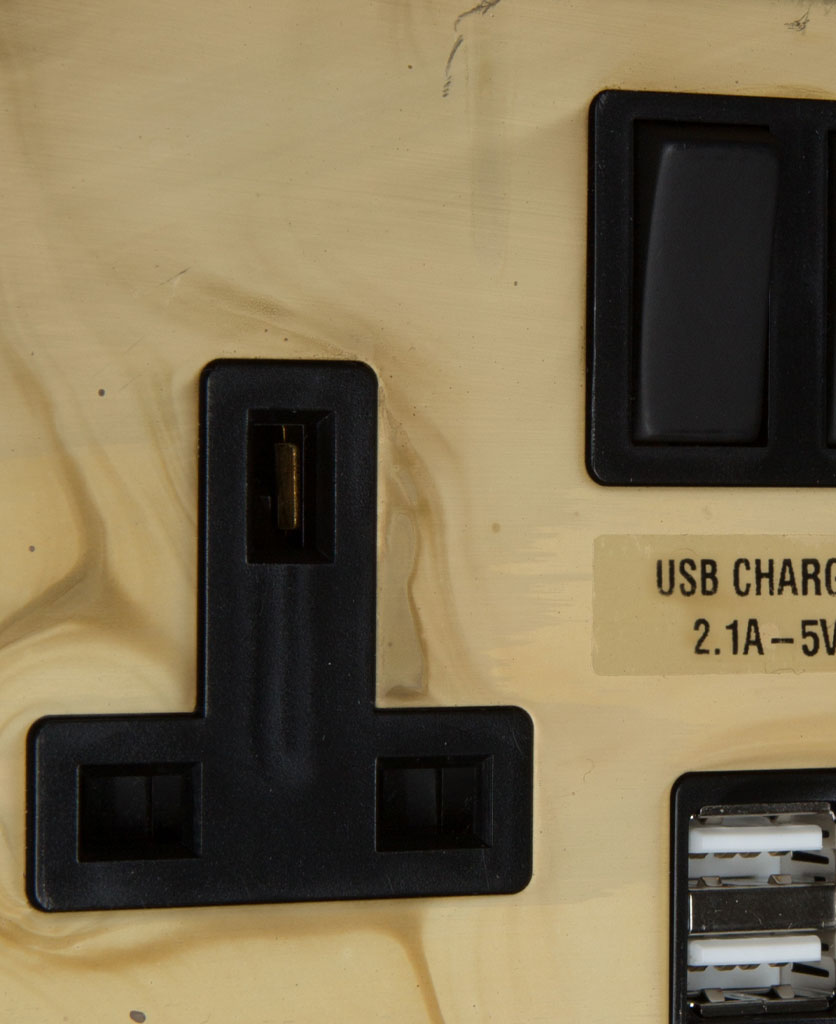 smoked gold and black plug socket with usb close up