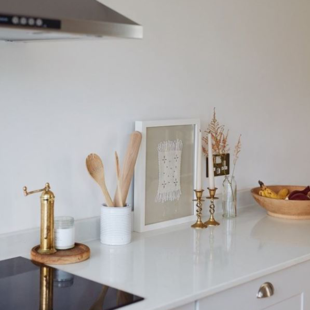 gold and white usb double socket on a white wall in a kitchen