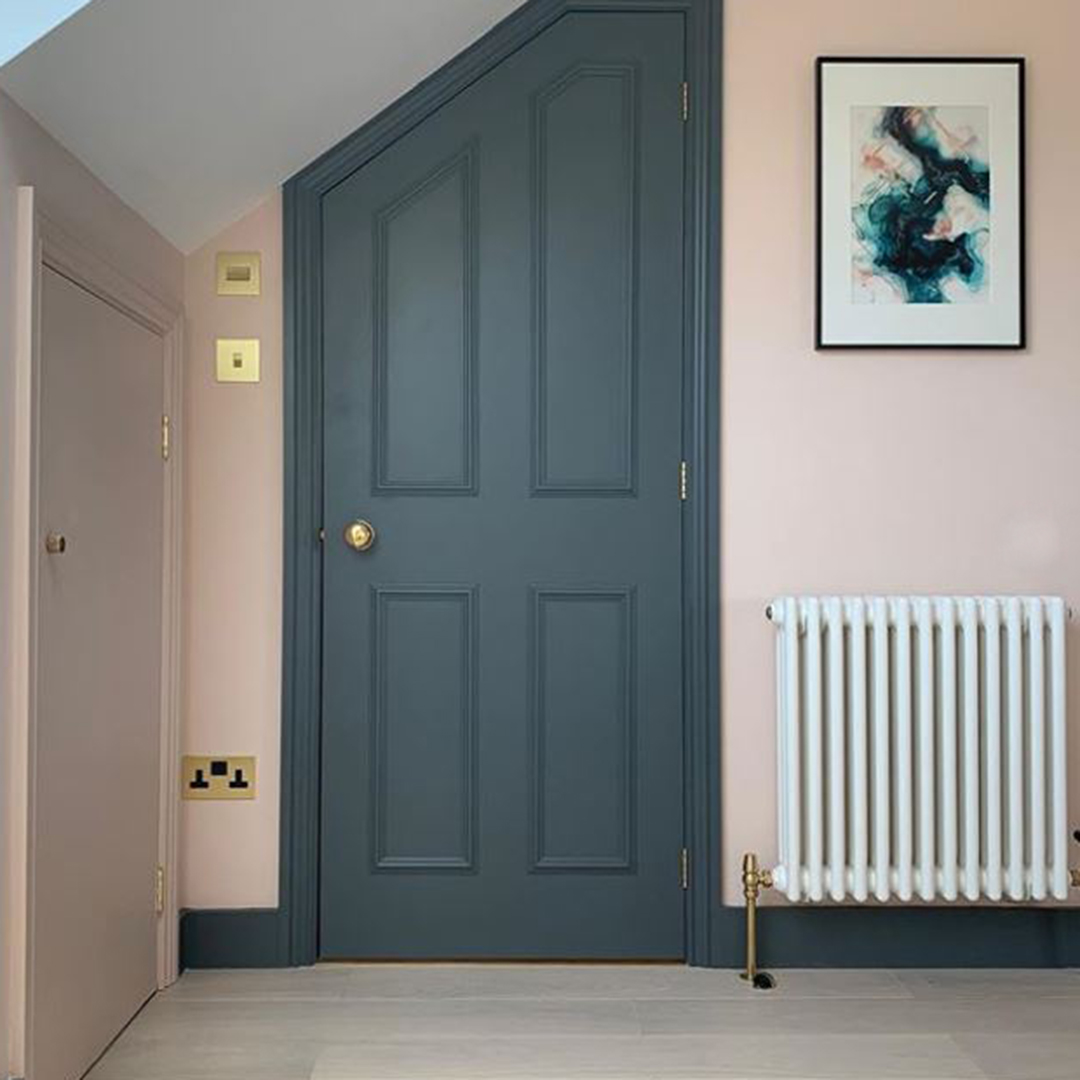 gold switches and sockets on soft pink wall