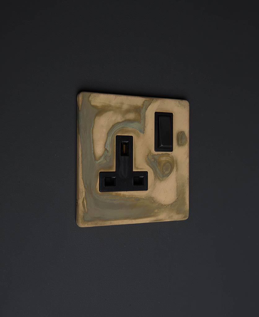 smoked gold & black single wall sockets against black background