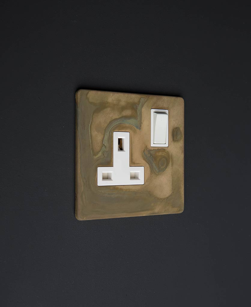 smoked gold & white single wall sockets on a black background