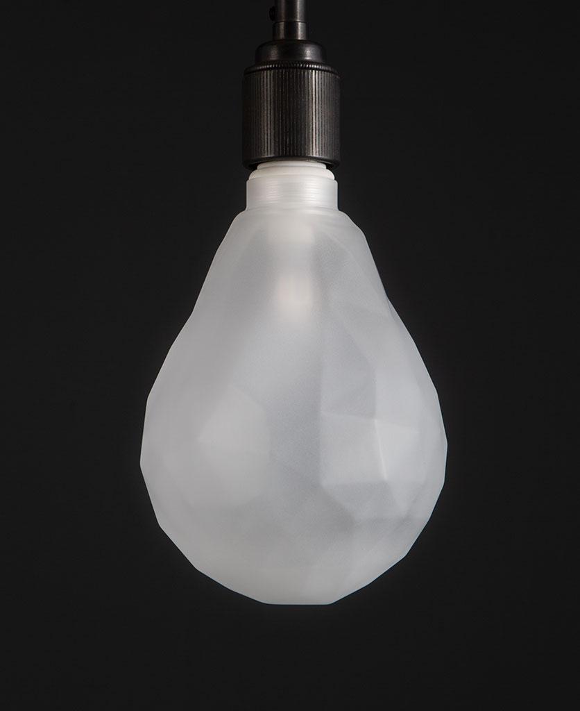 unlit pear geometric e27 led bulb frosted pear shaped bulb against black wall