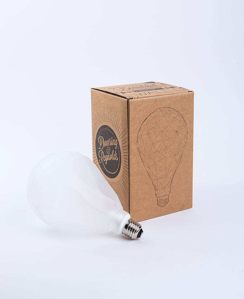 frosted pear geometric light bulb with cradboard box against white background