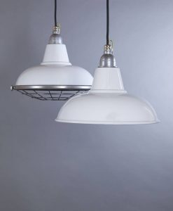 Morley white industrial lighting features enamel pendant lights for an undone finish