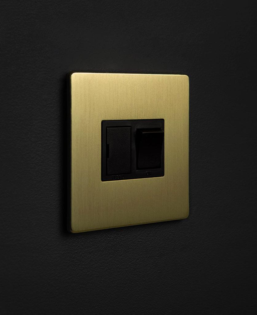 gold & black fused spur