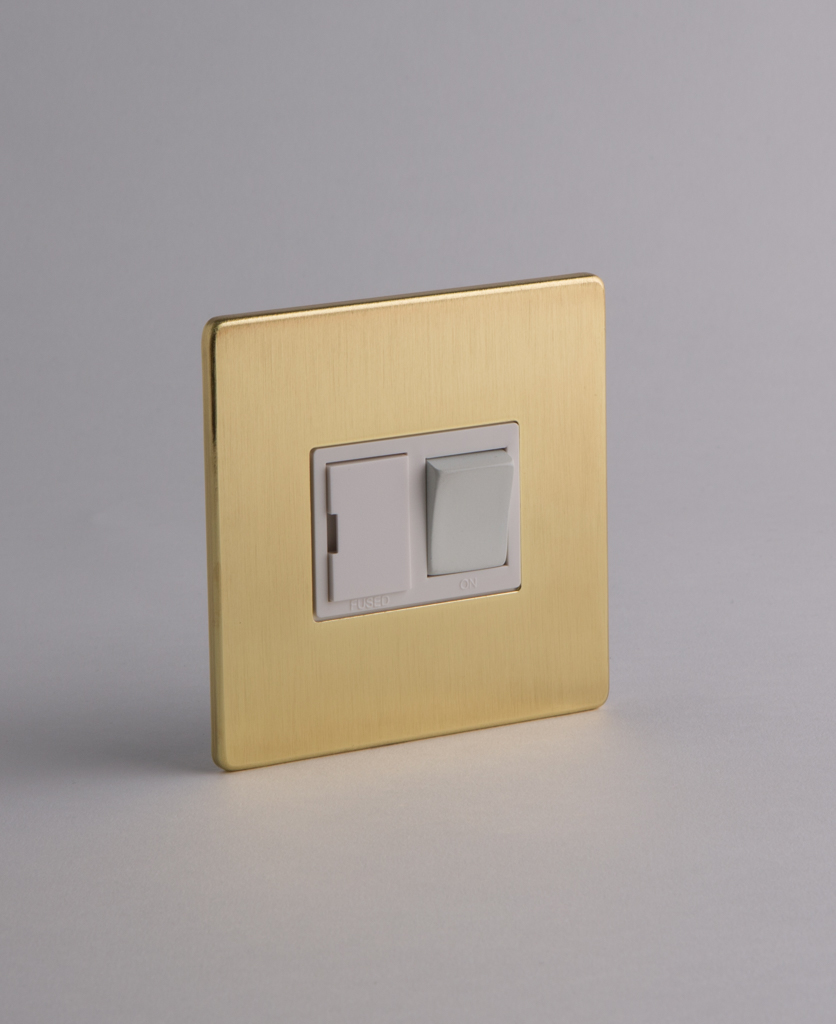 gold and white fused spur switch against white background
