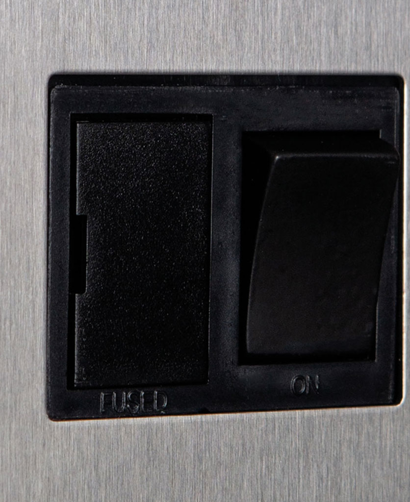 silver fused spur switch with black detail closeup