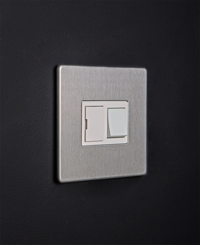 silver fused spur switch with white detail on dark background