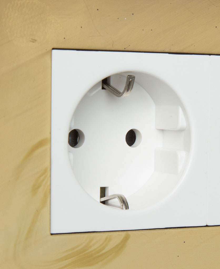 smoked gold and white double schuko plug socket close up