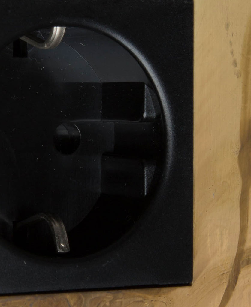 smoked gold and black single schuko plug socket close up