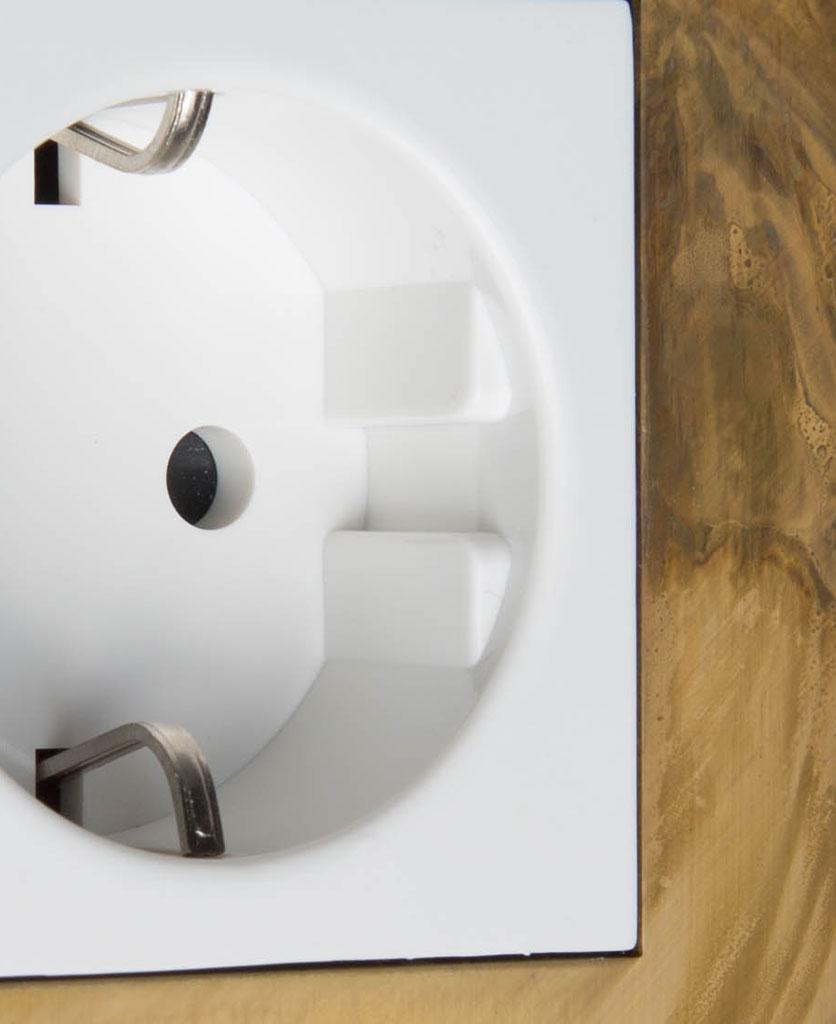 smoked gold and white single schuko plug socket close up