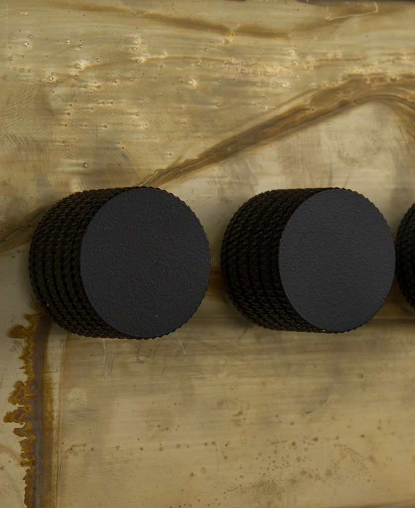 smoked gold triple dimmer switch with black knobs