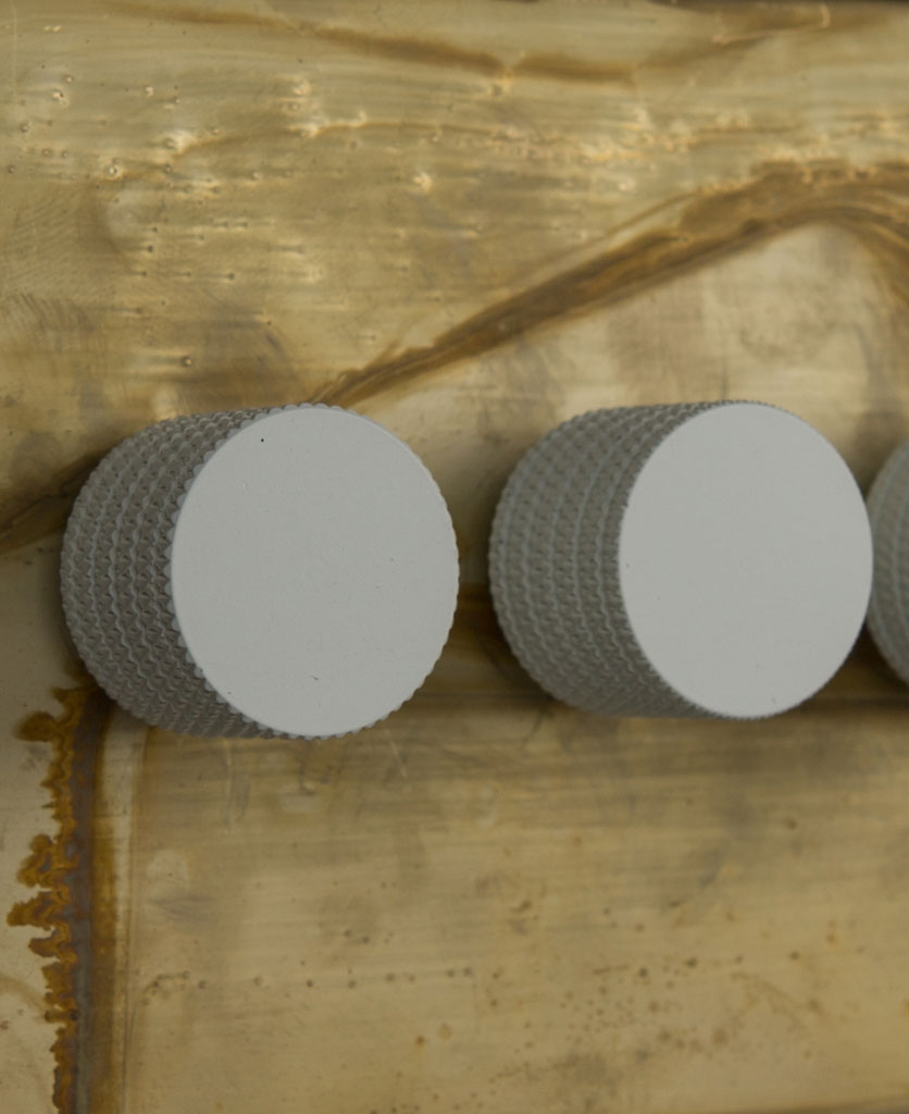 smoked gold triple dimmer switch with white knobs