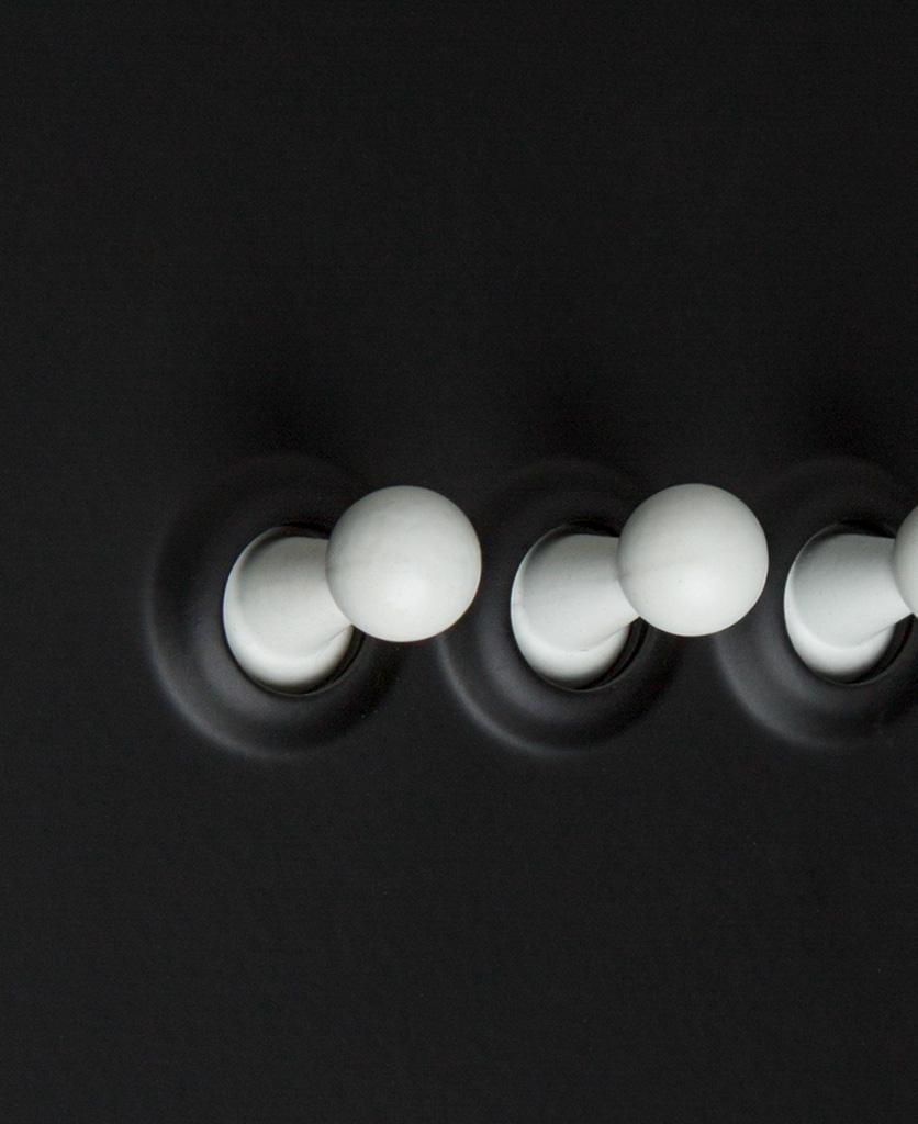 black 3g triple toggle switch close up
